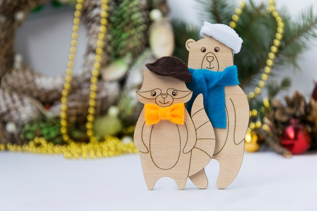 New year card with wooden toys bear and raccoon