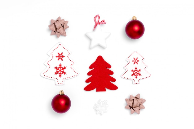 New year and christmas composition from red balls, white stars, chrismas tree, deer on white paper background. top view, flat lay, copy space, square, instagram, from above