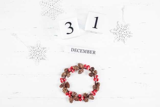 New year or christmas flat lay wooden calendar. 31 december