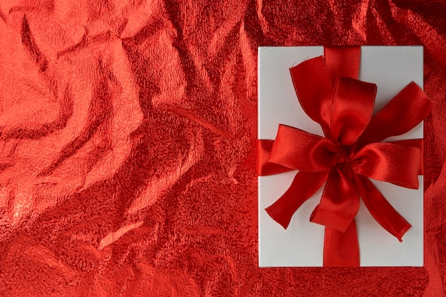New year or christmas gift box with red ribbon for holiday concept and valentine's day