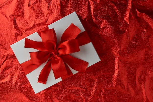 New year or christmas gift box with red ribbon for holiday