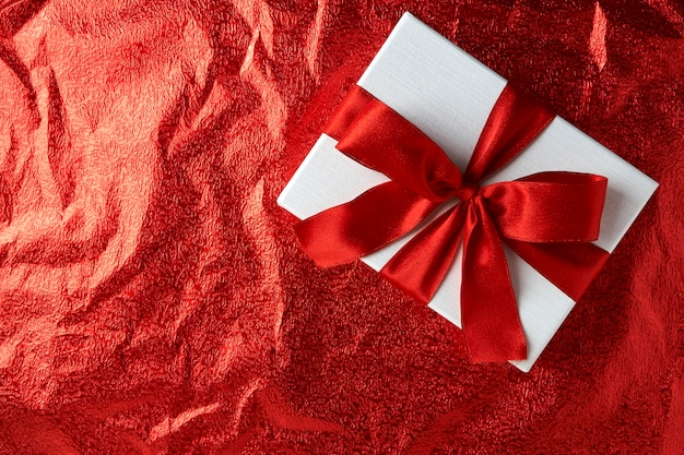 New year or christmas gift box with red ribbon