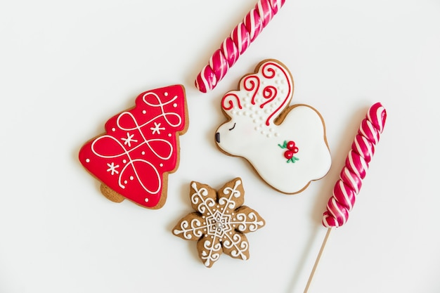 New year and christmas gingerbread cookies and christmas balls and candy. deer and tree shaped. christmas flatlay.