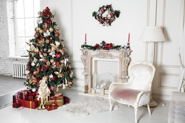 New year christmas holidays decorations in studio tree branches with baubles