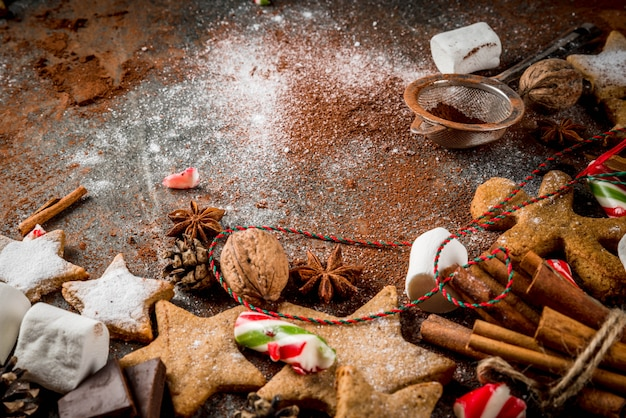 New year, christmas treats, sweets. cup of hot chocolate with fried marshmallow, ginger star cookies