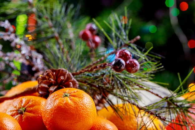 New year and christmas tree with gifts and mandarins.