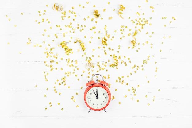 New year composition alarm clock golden confetti