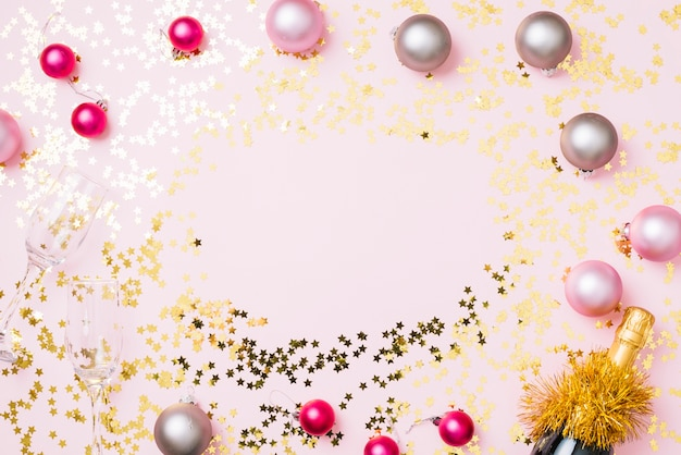 New year composition of baubles with spangles