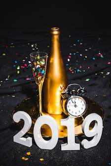 New year composition of champagne and clock
