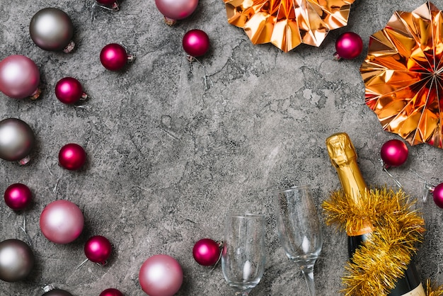 New year composition of glasses with baubles