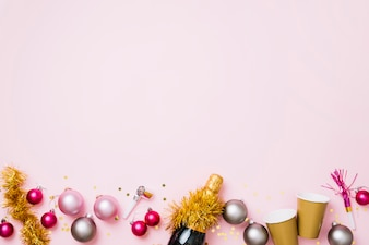 New Year composition of baubles with champagnebottle