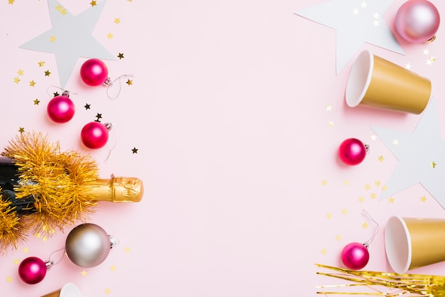 New year composition of paper cups with small baubles