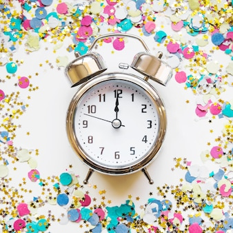 New year composition with alarm and confetti