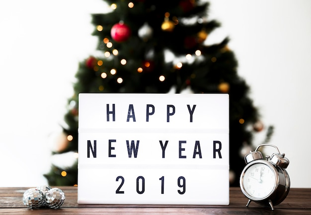 New year composition with greeting on table