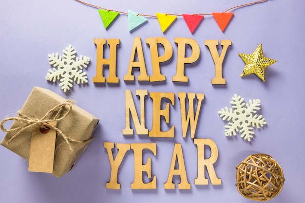 New year composition with letters and gift box