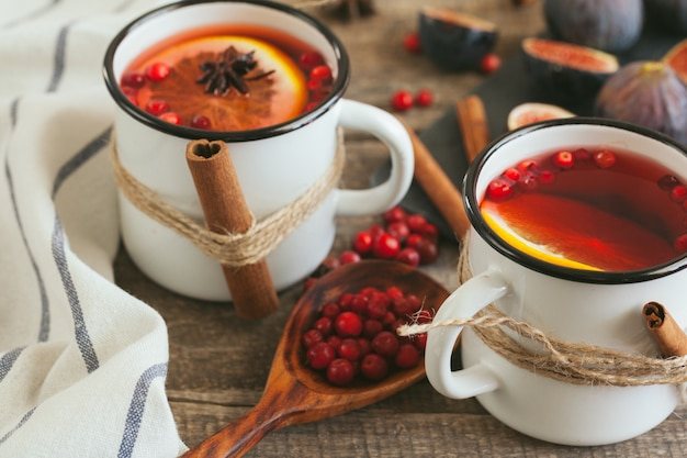 New year composition with mulled wine on dark wooden background