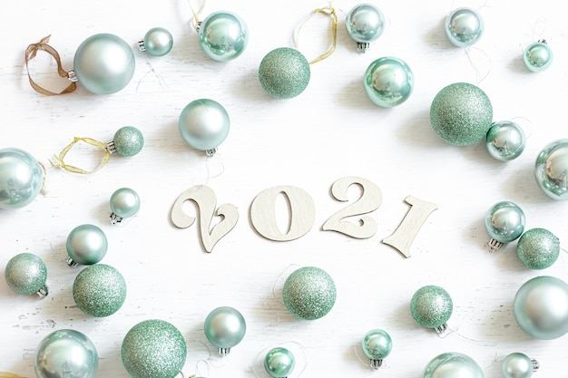 New year composition with wooden number for the coming year and blue christmas balls isolated.