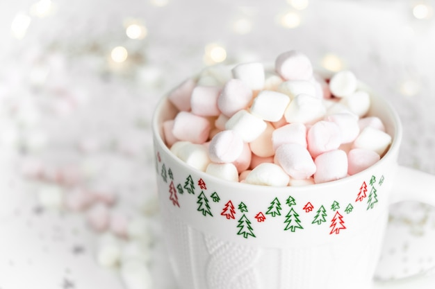 New year concept. cup with hot chocolate and marshmallows close up
