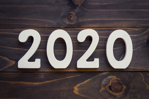 New year concept - number 2020 for new year on a wooden table.