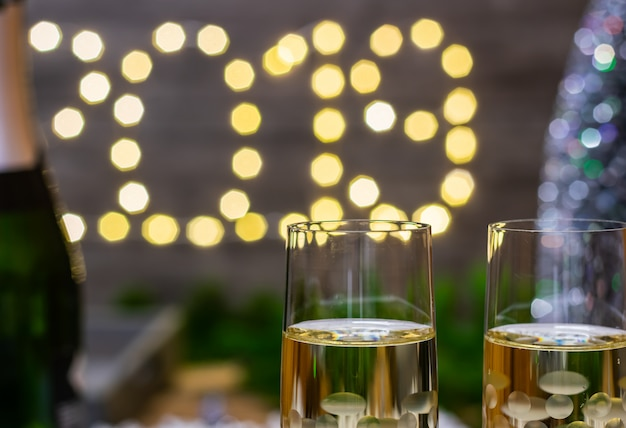 New year decoration concept-glass of champagne on blurred new year background