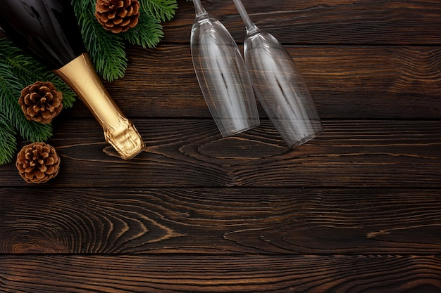 New year decoration with champagne bottle and fir branches