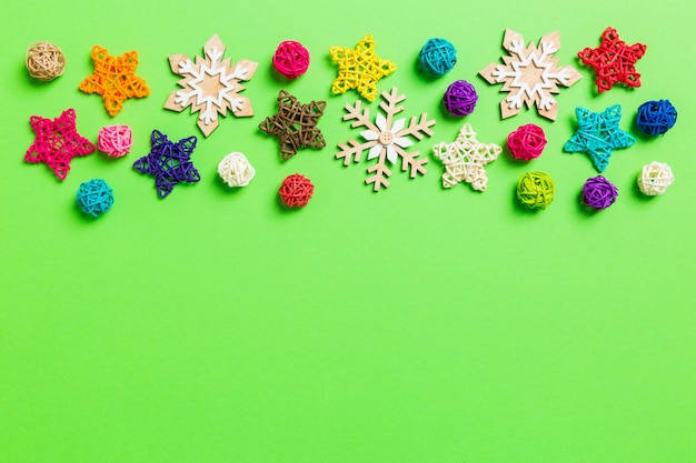 New year decorations on green background. festive stars and balls. merry christmas concept with empty space for your design