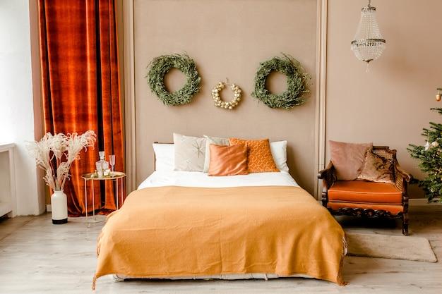 New year design interior of beautiful bedroom in beige tones with christmas tree