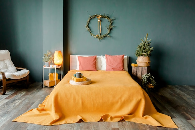 New year design interior of beautiful bedroom with wreath christmas tree spruce branches
