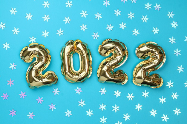 New year  foil balloons numbers  on blue background new year christmas