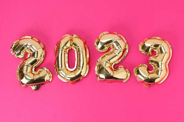 New year  foil balloons numbers  on pink background new year christmas