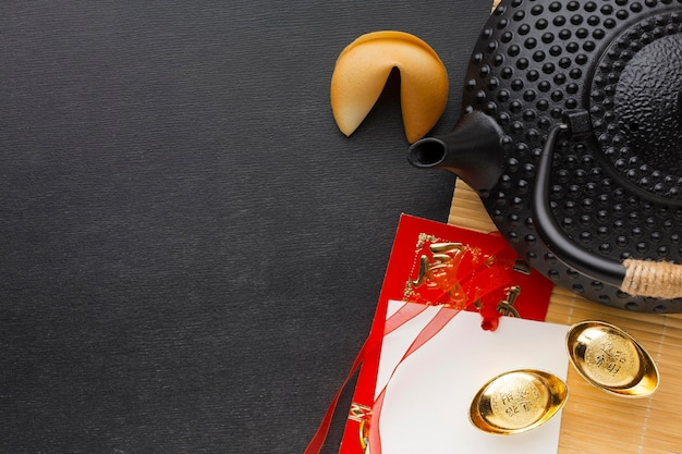New year fortune cookies and black teapot