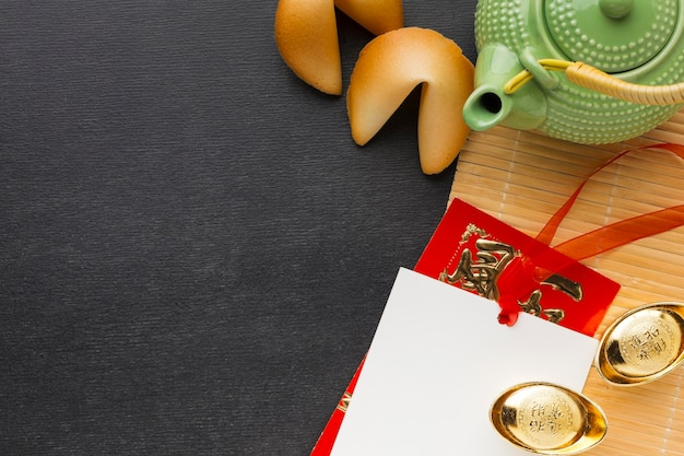 New year fortune cookies and green teapot