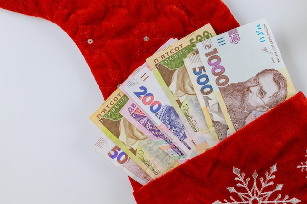 New year and happy christmas with ukrainian hryvnia money in red bag