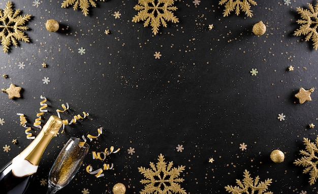 New year holidays concept made from champagne, glasses, stars, snow flake with golden glitter