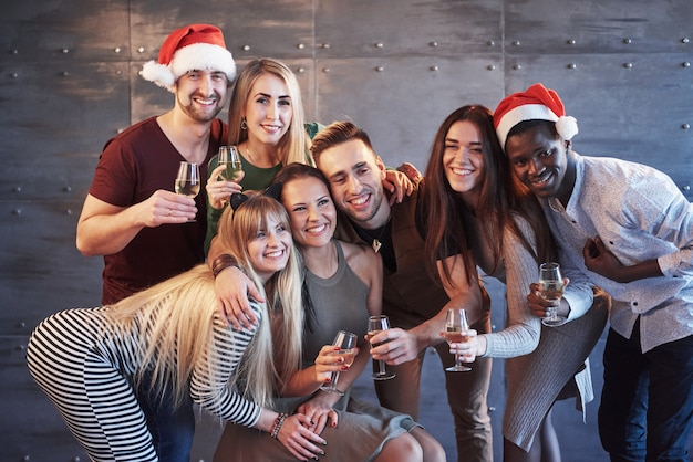 New year is coming! group of cheerful young multiethnic people in santa hats on the party, posing emotional lifestyle people concept