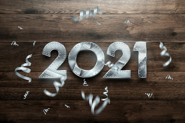 New year lettering 2021 with metal numbers on wooden background.