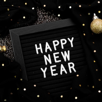 New year lettering on dark background with lights
