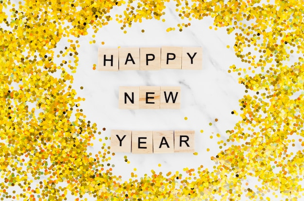 New year lettering on marble background and golden glitter