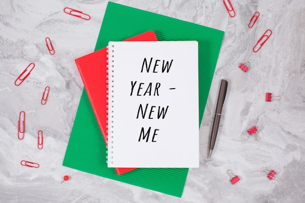 New year - new me and notebook on a on a table. inspiration concept, new year motivation, flat lay