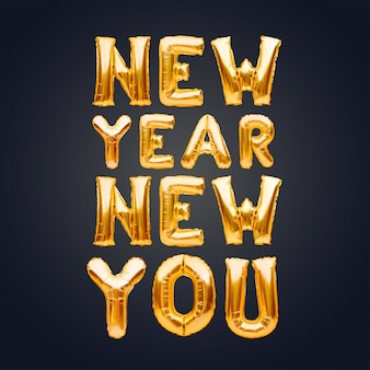 New year new you phrase made of golden inflatable balloons on dark background, new goal concept.