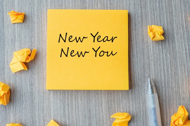 New year new you word on yellow note