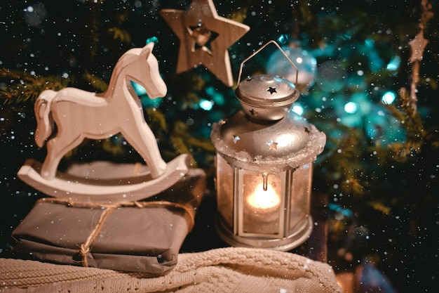 New year night decoration with gifts candles and antique decorations