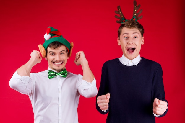 New year party concept happy fun smiling charming handsome hipster man guys male celebrating winter christmas holidays
