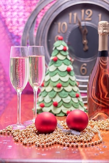 New year party decoration with champagne and clock close to midnight
