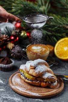 New year's breakfast with croissants. new year's croissant with chocolate and baked orange