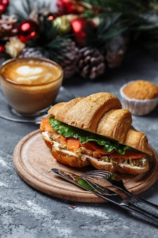 New year's breakfast with croissants. new year's croissant with red fish and avocado