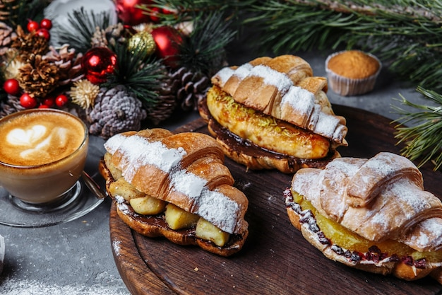 New year's breakfast with croissants. set of three new year's croissants. new year's croissants with