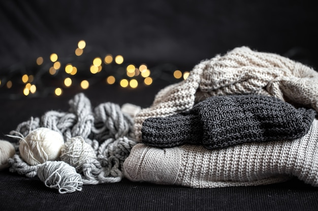 New year's composition with knitted items on a dark background.