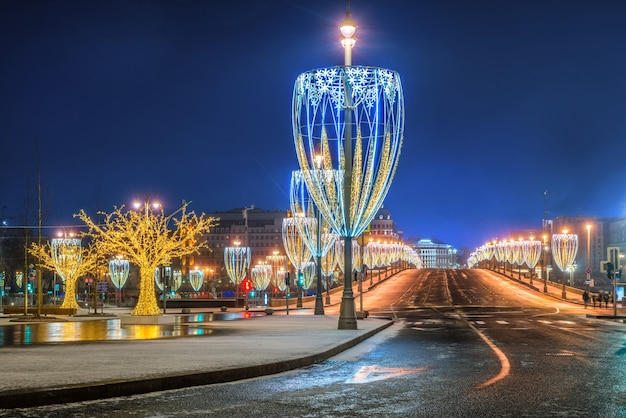 New year's decorations in moscow in the form of tulips on poles along the edges