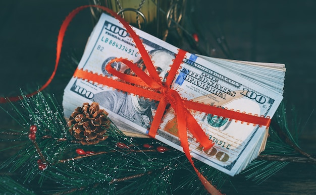 New year's gift 100 usa dolllars against the background of the american currency